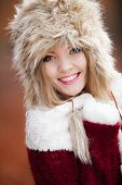 Woman In Winter Clothing Fur Cap Outdoor