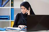 Arab Businesswoman Watching Documents