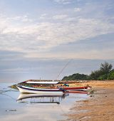 Boats On Sanur Beach At Dawn In Bali, Indonesia.