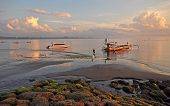 Bali Fishermen Preparing Their Boat At Dawn At Sanur Beach.