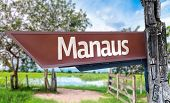 Manaus wooden sign with rural background
