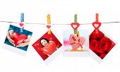 Photo cards hanging on the clothesline isolated on white, Valentine's Day concept