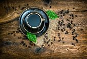 Cup Of Black Coffee With Beans On Wooden Background