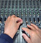 Hands Operating Music Mixing Desk
