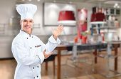 Young professional chef man in modern kitchen