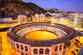 Malaga, Spain downtown skyline over the bullring.