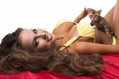 Portrait of beautiful model caresses kitten