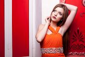 Sensual Girl On Red Vintage Wall