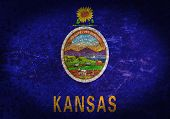 stock photo of kansas  - Old rusty metal sign with a flag  - JPG
