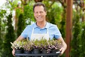 Enjoying His Work With Plants.