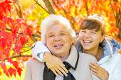 Happy Portrait Of Grandmother And Granddaughter