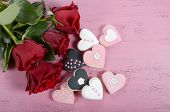 Romantic Heart Shape Pink, White And Black Cookies With Red Roses And Copy Space On Vintage Shabby C