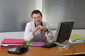 Successful Businessman Sit At His Desk