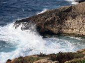 High Cliff On The Sea With Waves
