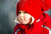 Cute Little Girl Playing With Snow