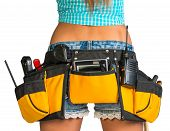 Woman wearing tool belt with tools, close up