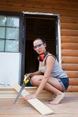 Pretty Young Woman Builder With Saw