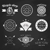Set of vintage bike shop logos. White logo on black chalk board.