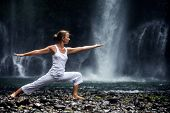 Woman Meditating Doing Yoga Between Waterfalls