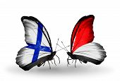 Two Butterflies With Flags On Wings As Symbol Of Relations Finland And Monaco, Indonesia