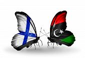 pic of libya  - Two butterflies with flags on wings as symbol of relations Finland and Libya - JPG