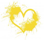 Heart made of yellow paint splashes isolated on white