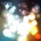 Shiny lights abstract background. Vector design