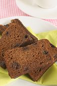 stock photo of malt  - Malt Loaf a heavy soft fruit loaf made with malt extract also known as raisin bread or harvo - JPG