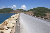 Road over the dam of the High Island Reservoir at the Hong Kong Global Geopark Hong Kong, China.