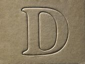 die cut alphabet d on the brown card board