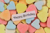 Happy birthday card with colorful sugar hearts