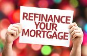 Refinance Your Mortgage card with colorful background with defocused lights