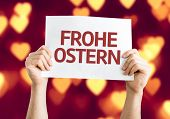 Happy Easter (in German) card with heart bokeh background