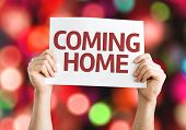 Coming Home card with colorful background with defocused lights