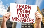 Learn From Your Mistakes card with a urban background