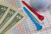 Golf Equipments And Us Dollar Banknotes