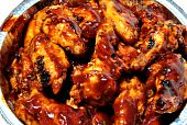 pic of chicken wings  - A picnic container full of hot spicy barbequed chicken wings - JPG