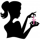 An image of a silhouette of a girl opening a gift box.