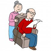 An image of a senior couple reading a document together.