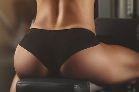 image of body shapes  - Brutal athletic woman pumping up muscles with dumbbells - JPG