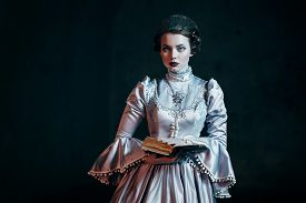 image of dungeon  - Woman in victorian dress imprisoned in a dungeon