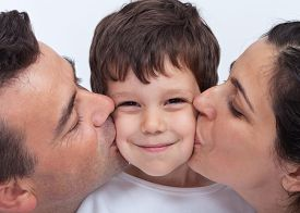 image of cuddle  - Loving family with a kid  - JPG