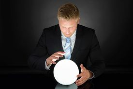 image of oracle  - Portrait Of Businessman Predicting Future With Crystal Ball - JPG