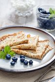 foto of crepes  - close up view of nice yummy crepes with berry on table - JPG
