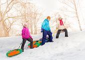 stock photo of children walking  - Children walking and carry tubes with laces  during frost winter day together - JPG