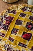 picture of tarts  - Shortbread tart with cherries with beautiful grid sprinkled with almonds - JPG
