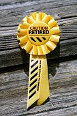 stock photo of retired  - A ribbon to help celebrate a person - JPG