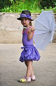 Toddler girl with umbrella