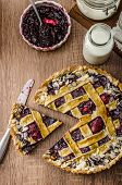 image of tarts  - Shortbread tart with cherries with beautiful grid sprinkled with almonds - JPG