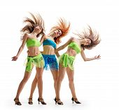 picture of triplets  - young beautiful dancers in bright dresses on a white studio background - JPG